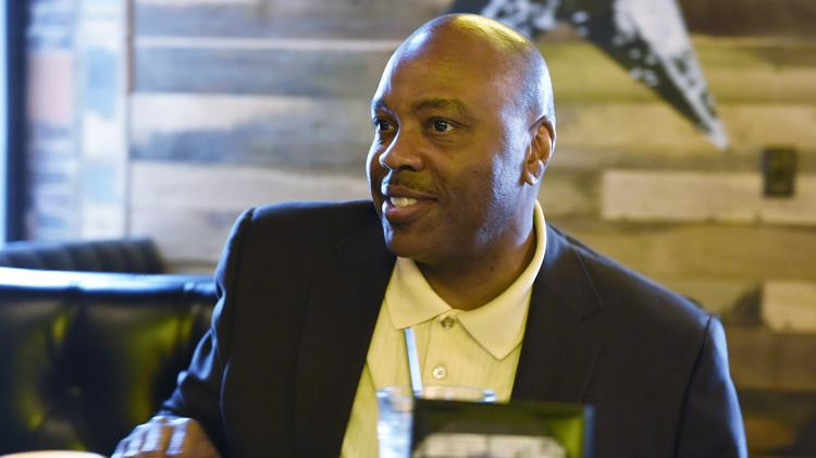 A rare smile from RTD boss Phil Washington at the restaurant Southern Hospitality in LoDo, where he met with columnist Bill Husted.