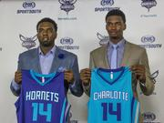 P.J. Hairston (left) and Noah Vonleh (right) discussed their new NBA home on Friday in Charlotte.