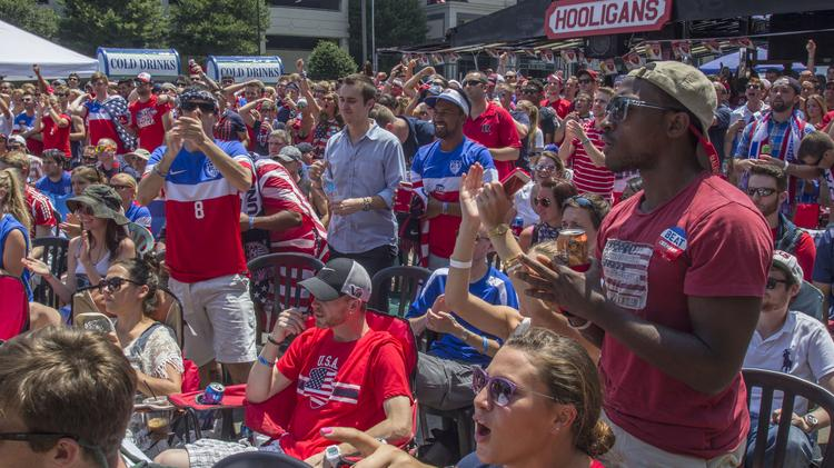 Fans at Courtyard Hooligans in uptown cheered Team USA during their match against Germany last week. Today, the U.S. team plays Belgium at 4 p.m., with similar viewing parties planned.