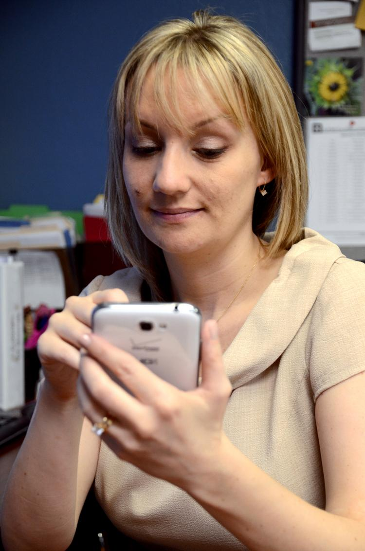 Sarah Blake in the Elipsis Engineering offices with her smart phone