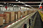Boxes that weigh up to 80 pounds, called overhead packages, are automatically sorted on a conveyor belt that moves at a rate of 540 feet per minute. Heavier or oversized packages are hand-sorted.