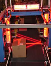 The automated scanner weighs boxes, calculates the dimensions and reads bar code labels to determine the zip code where the boxes are headed.