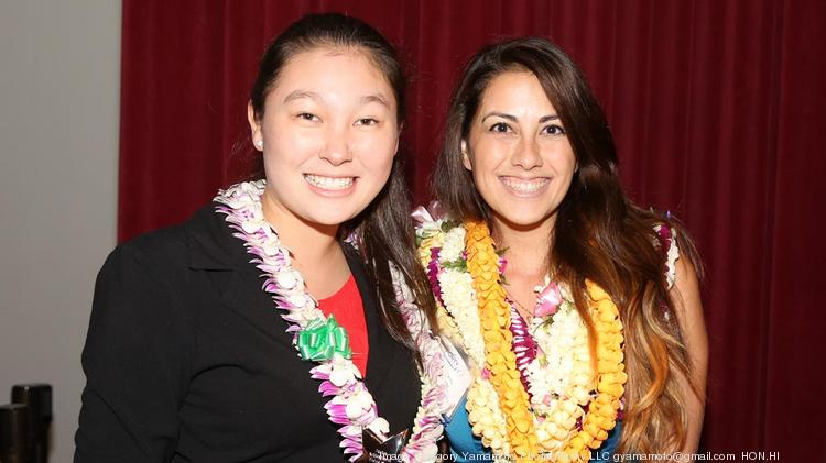 Jennifer Taniguchi, left, received the Junior Achievement Rising Star Award Thursday during PBN's Forty Under 40 event from Kimberly Canepa, executive director of Junior Achievement of Hawaii.