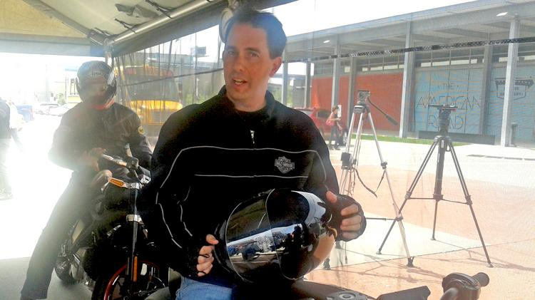 Wisconsin Gov. Scott Walker chatted with Harley-Davidson staff after taking the LiveWire prototype for a test drive.