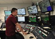 John Lee, operations manager in the central control room, checks video from multiple surveillance cameras and other monitors inside the distribution hub.