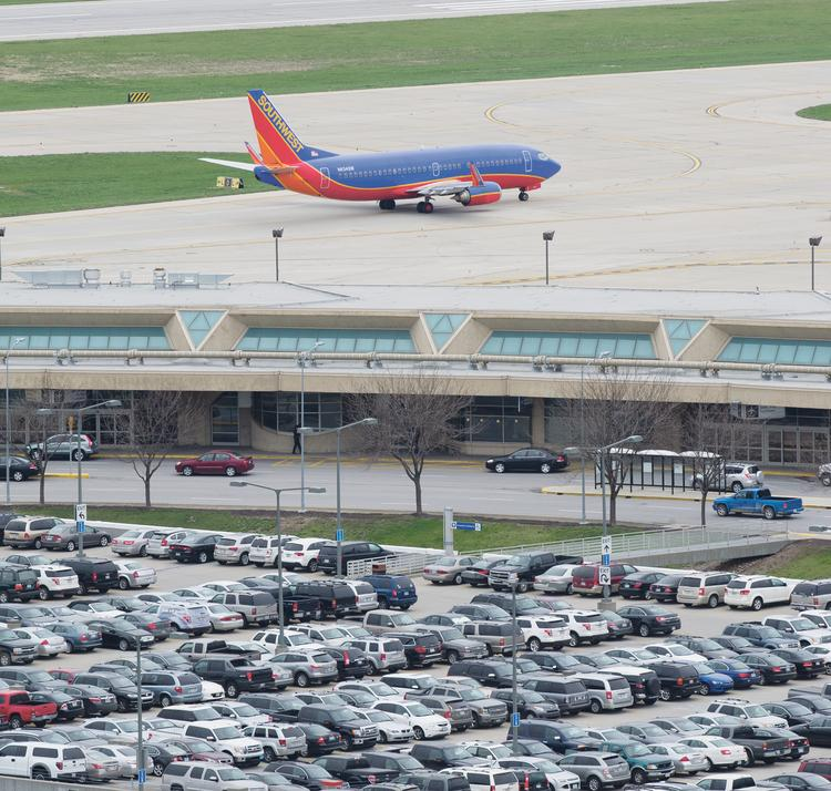 A Southwest Airlines jet taxis past Terminal B at Kansas City International Airport.