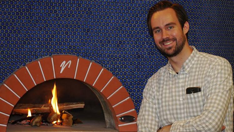 Executive Chef Andy Vyskocil said the wood-fired pizza oven at Rival House, a new restaurant at the Double Tree in St. Paul, had to be seasoned by flame before the June 30 opening.
