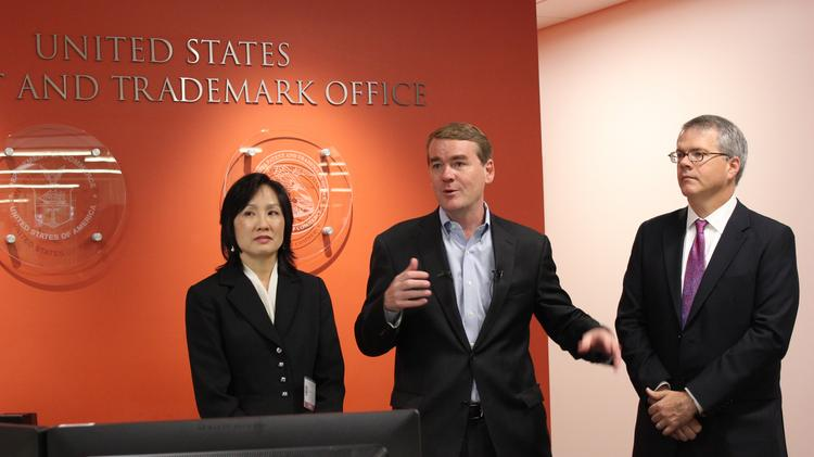 U.S. Sen. Michael Bennet (center), along with Michelle Lee, U.S. Patent and Trade Office deputy director, and Bruce Andrews, acting deputy secretary of commerce, answer questions about Denver's new patent office.