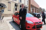 Jim Plaisted, executive director of the East Side Business Improvement District, with one of the Zipcars that will be available on North Avenue.