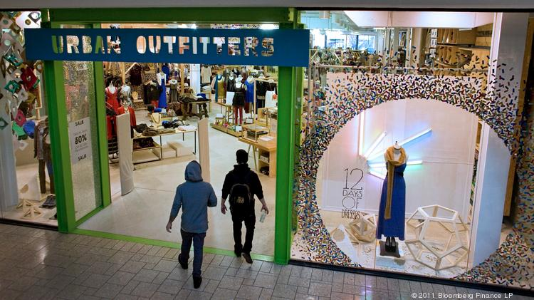 Shoppers enter an Urban Outfitters store at the Cherry Creek Shopping Center in Denver in 2011.