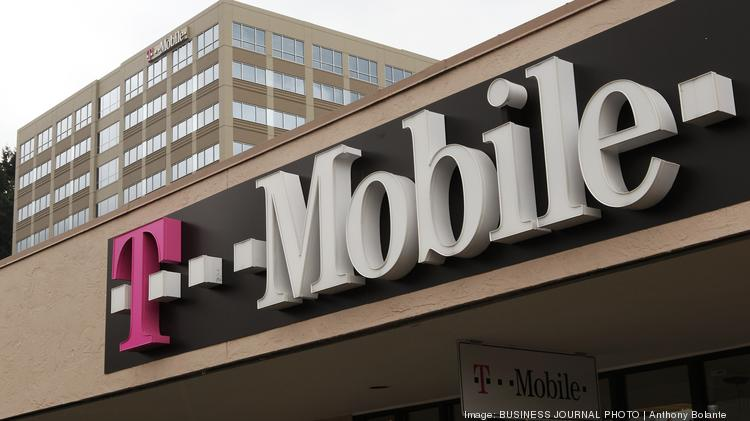 A T-Mobile store is pictured in front of the company's corporate headquarters campus in Bellevue, Wash.