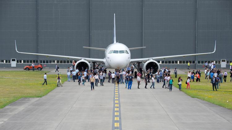 The first Airbus A320neo has a paint job and its engines are mounted.