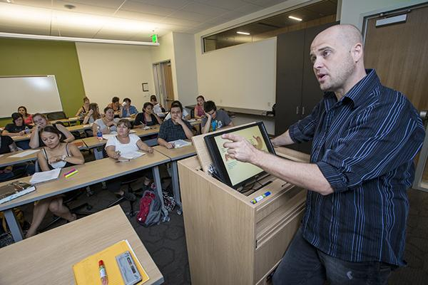 Dr. Timothy Cejka, an adjunct professor at GateWay Community College in Phoenix, teaches a biology class. He is one of scores of staff members whose hours could be cut so the Maricopa Community Colleges can save $13 million by not giving them health insurance under the Affordable Care Act.