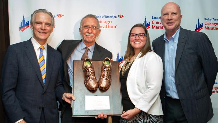 Presenting Jim Jenness (second from left) with the Richard M. Daley and Maggie Daley Award were Tim Maloney (left), Illinois president of Bank of America; Lalley Daley Hotchkiss, daughter of former Chicago Mayor Richard M. Daley, and Bank of America Marathon director Carey Pinkowski (far right).