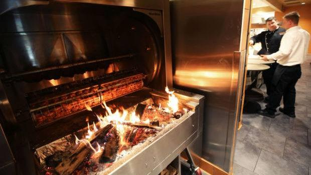 A shot of the rotisserie at the new Doolittles Woodfire Grill in Madison, Wis. The wood grill is a signature for the chain, which includes Eagan, Alexandria, Golden Valley, and Fargo, ND.