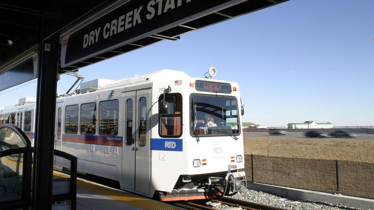 A F-line train enters the Dry Creek Station.