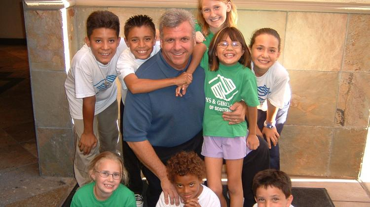 Steve Schwanz with children from the Boys & Girls Clubs of Greater Scottsdale.
