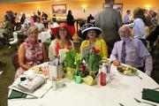 Tina Cline, left, Lynn Hasson, Susan Rein and Mike Cook were seated at the Derby City Litho table.