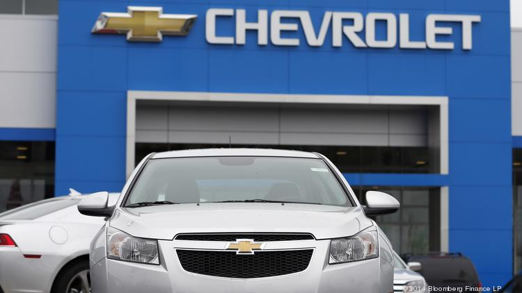 A General Motors Co. 2014 Chevrolet Cruze vehicle sits on the lot at a dealership in Southfield, Michigan. General Motors Co. said it has instructed dealers to stop selling some 2013 and 2014 Chevrolet Cruze compact cars with 1.4-liter engines while not saying why the halt was ordered. The Cruze isn't part of the recall of 1.6 million cars that GM has been dealing with after faulty ignition switches were linked to the deaths of 12 people. Photographer: Jeff Kowalsky/Bloomberg