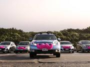 Lyft vehicles are identified by their iconic pink mustaches.