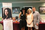 Staffing the J Michael's Spa & Salon booth outside Millionaires Row for the day were, from left, Alicia Watkins, Jill Higginbotham and Matthew Chappel. Higginbotham said the salon was offering products such as lip gloss, hair spray and other items people might have forgotten to bring with them.