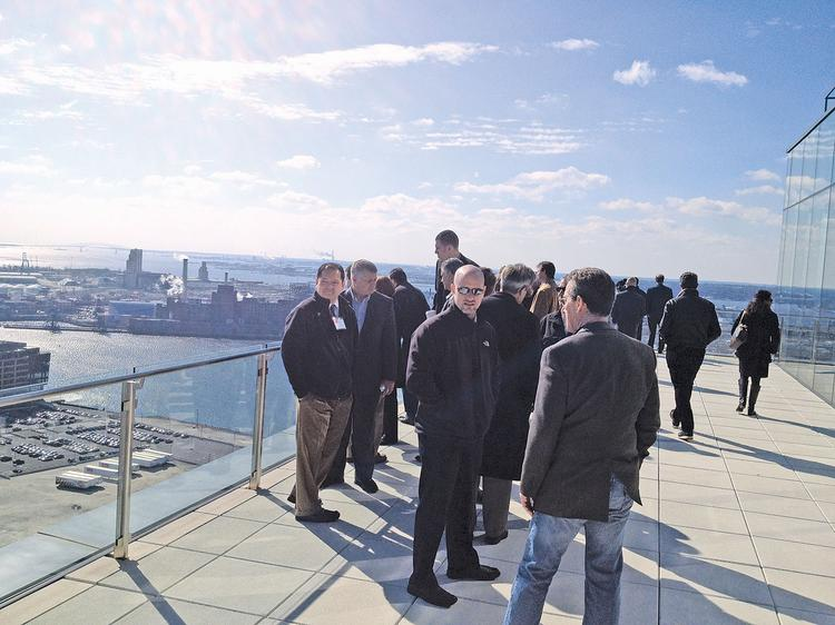 A tour of Regus' space in the Legg Mason tower shows off water views.