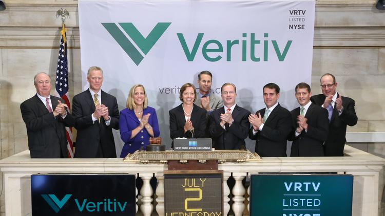 Executives from Veritiv Corp. ring the New York Stock Exchange bell on July 2, 2014.