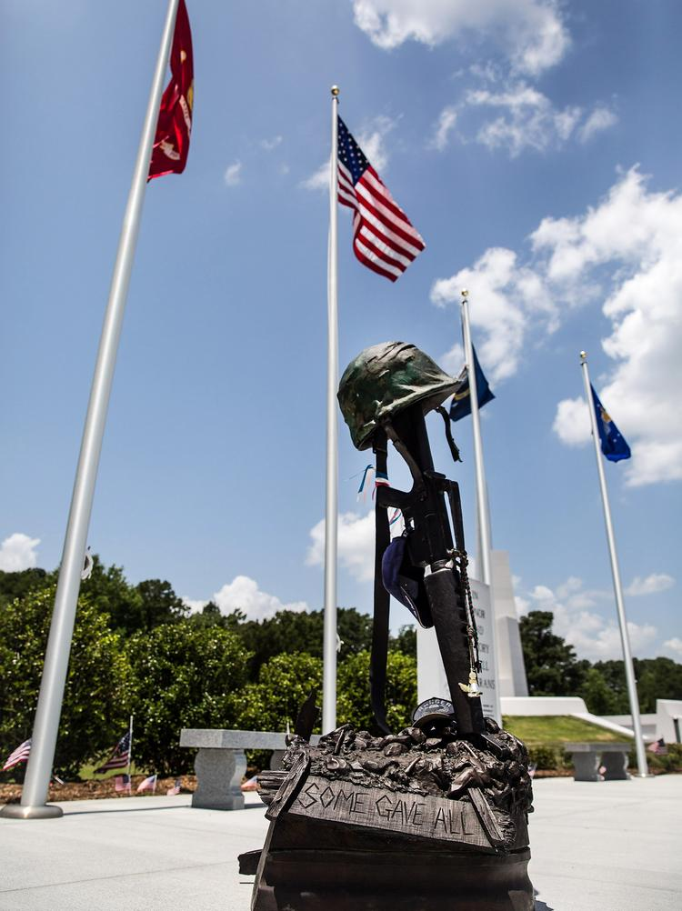 A small monument dedicated to the veterans of past, present and future wars, that was previously installed at the Veterans Freedom Park in Cary in 2007, stands in its new place at the recently redesigned park on July 2. The 13-acre park, near North Harrison Avenue and Cary Parkway, underwent recent renovations to install a 90-foot spire made of granite. The creator of the park was the National Veterans Freedom Park Foundation (NVFP), designed by Howard Meehan, with support coming from the Town of Cary, SAS Institute and local residents.