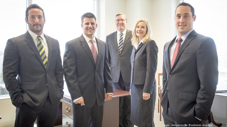 Nathan Rogero, George Ossi, Roger Dominey, Grace Staten and Philip Rogero of Financial Design Associates.
