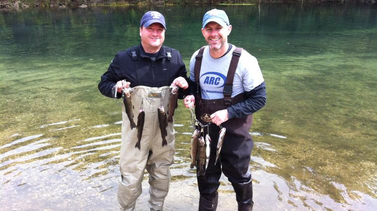 """Brian Stewart, ARC Physical Therapy+, (right) fishes often at Bennett Springs State Park outside of Lebanon, Mo. """"I've been going down there to trout fish every year since I was 6. It was one of my dad's favorite places, so it's pretty special to me,"""" he said."""