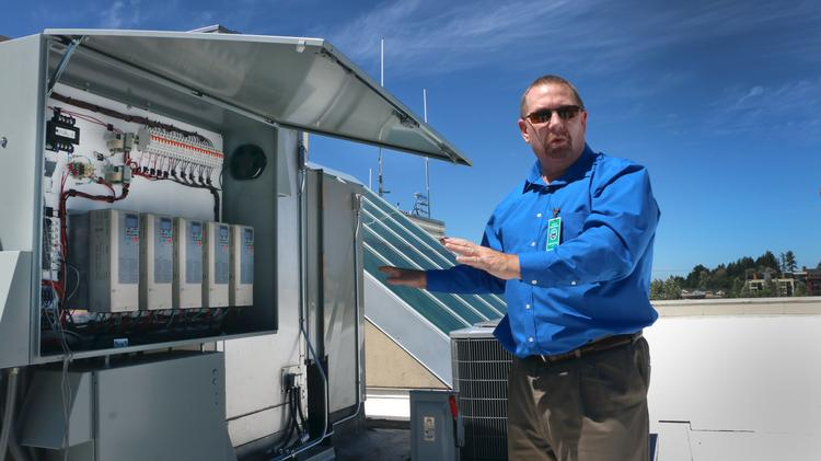 David Neketin, principal with IT Aire, explains the controls and drives that power its data center cooling technology. The system installed at Gresham City Hall used 78.5 percent less energy, according to an Oregon State University researcher.