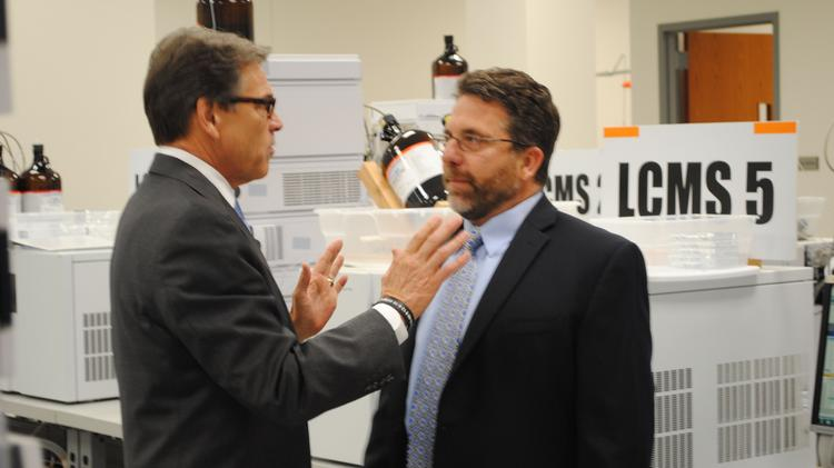 Texas Gov. Rick Perry (left) chats with Joe Wiegel, CEO of PCLS, during his Rock Hill tour with U.S. Rep. Mick Mulvaney.