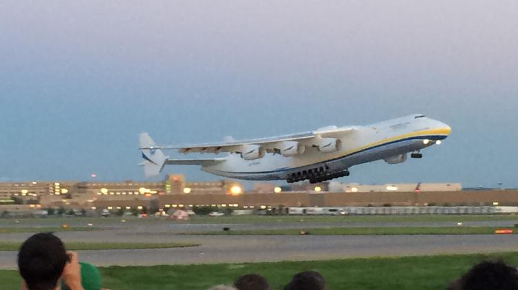 A crowd watched the Antonov An-225 fly out of Minneapolis-St. Paul International Airport Wednesday night.