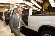 Joe Hinrichs, Ford's president of the Americas, walks past a completed Ford F-150 truck at the Ford Kansas City Assembly Plant in Claycomo.