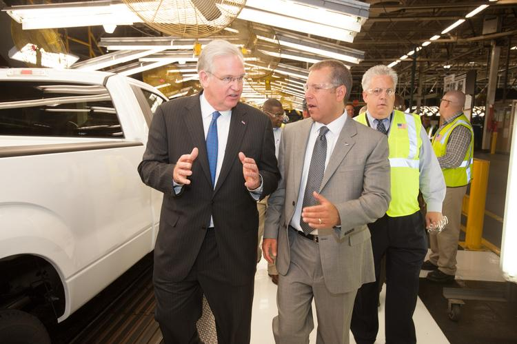 Missouri Gov. Jay Nixon (left) and Joe Hinrichs, Ford's president of the Americas, talk while walking the F-150 production line at the Ford Kansas City Assembly Plant in Claycomo.