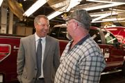 Joe Hinrichs visits with an worker on the F-150 production line at the Ford Kansas City Assembly Plant.