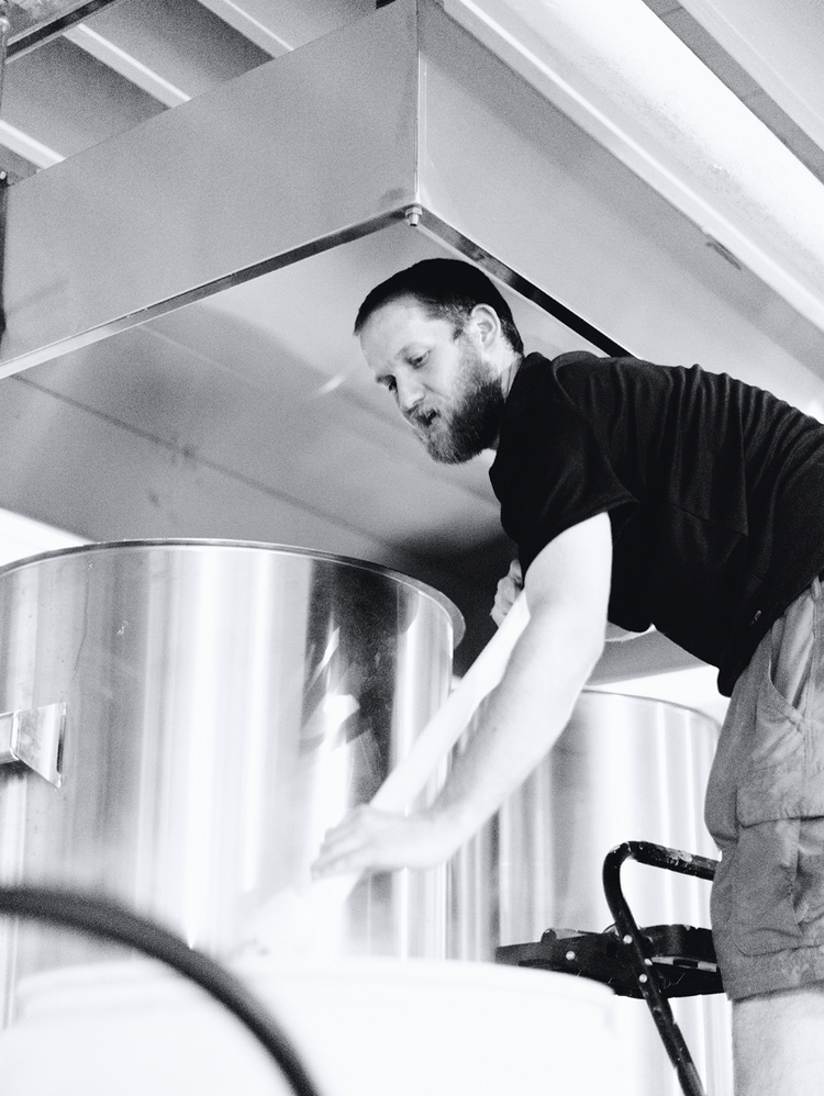 Owner Samuel Harriman works a brew kettle at Sisyphus Brewing Co. The new microbrewery can have up to 10 different beers in process at one time.