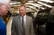 Joe Hinrichs, Ford's president of the Americas, chats with autoworker Rick Empson.