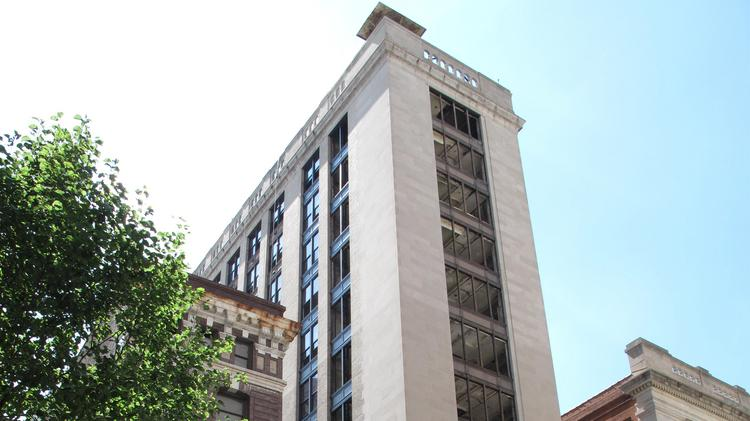 The former U.S. F&G Co. building at 26-28 S. Calvert St. is being converted to 78 apartments by PMC Properties Group.