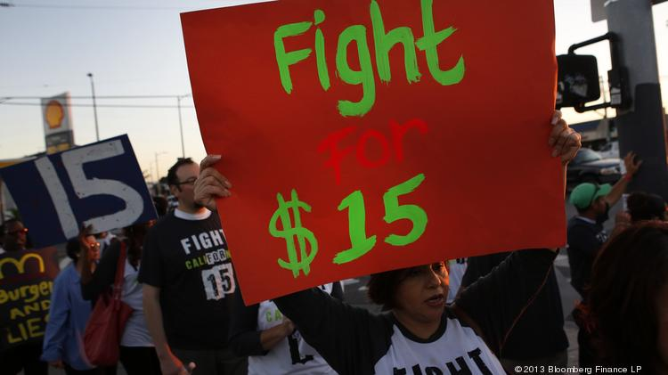 Fast-food workers and supporters organized by the Service Employees International Union protest outside of a Burger King restaurant in Los Angeles last year. Some fast-food workers are demanding the right to wages of $15 an hour, more than double the federal minimum of $7.25.