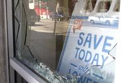 A window of Walgreens Pharmacy remains shattered in Seattle's Capitol Hill neighborhood.  Several businesses suffered damage but were open Thursday after protesters marched through the Capitol Hill neighborhood Wednesday night.