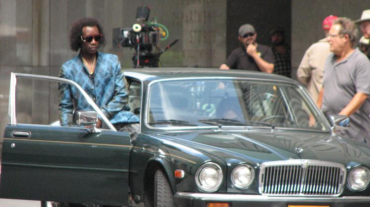 "Don Cheadle gets into a car used in ""Miles Ahead"" during filming in downtown Cincinnati."