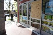 A window of Walgreens Pharmacy was shattered after protesters marched through Seattle's Capitol Hill neighborhood May 1. The business was open Thursday.