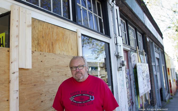 Don Stevens, owner of Bill's Off Broadway tavern and sports bar, outside his business, which was damaged May 1. Several businesses suffered damage but were open Thursday after protesters marched through the Capitol Hill neighborhood Wednesday night.