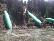 These fuselages, which knocked off a train from Wichita on July 3, are now nearly shredded.