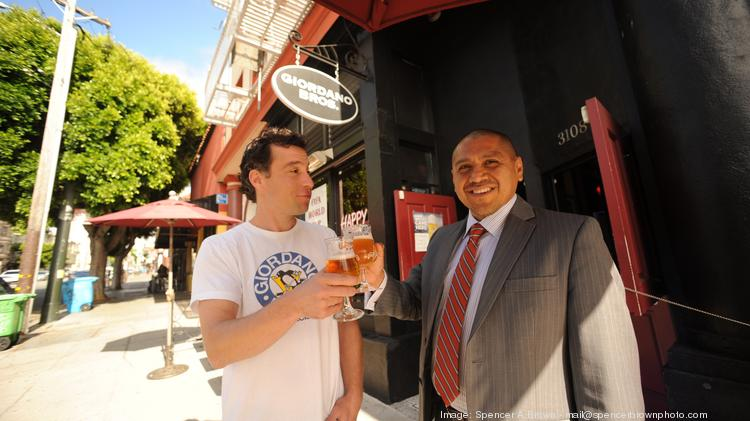Giordan Bros. co-owner Adam DeMezza (left) and real estate broker and consultant Louis Cornejo (left) toast the eatery's success in nabbing the perfect spaces for its two San Francisco locations.