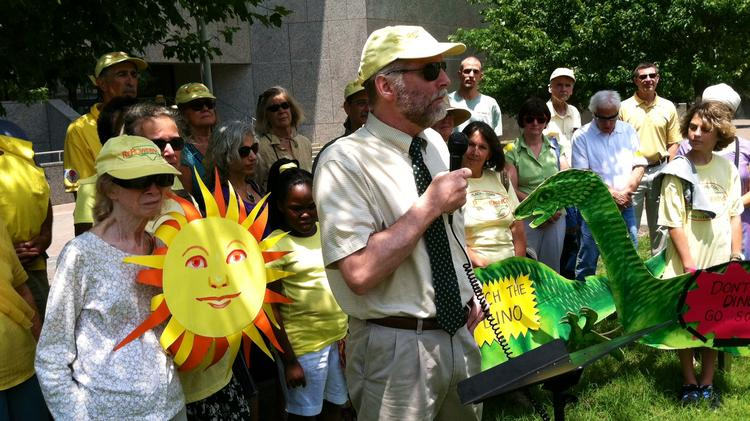 Jim Warren, executive director of NC WARN, speaks to solar power supporters before a hearing at the N.C. Utilities Commission.