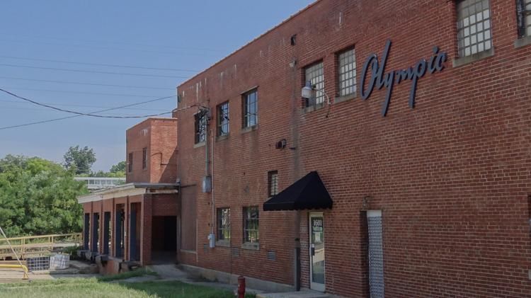 The Olympic Mill complex and accompanying 17 acres on Yanceyville Street in Greensboro has been sold for $2.4 milion to Durham-based Self Help Ventures Fund.