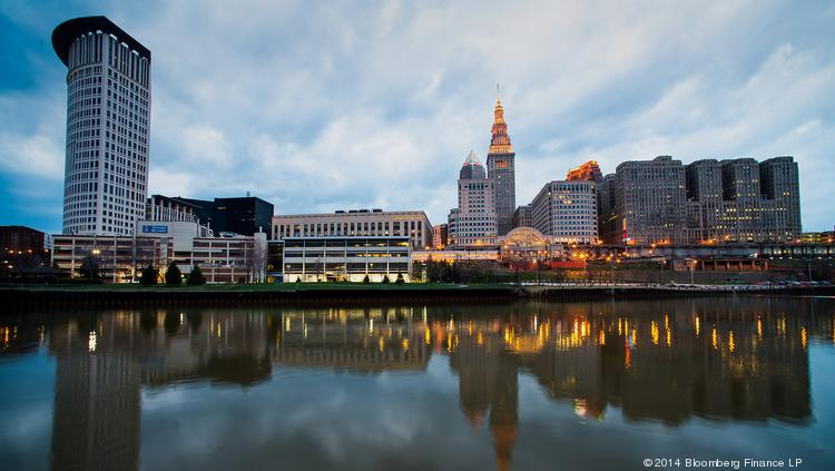 Cleveland's skyline is reflected in the Cuyahoga River; Republicans selected the Ohio city to host their 2016 convention.
