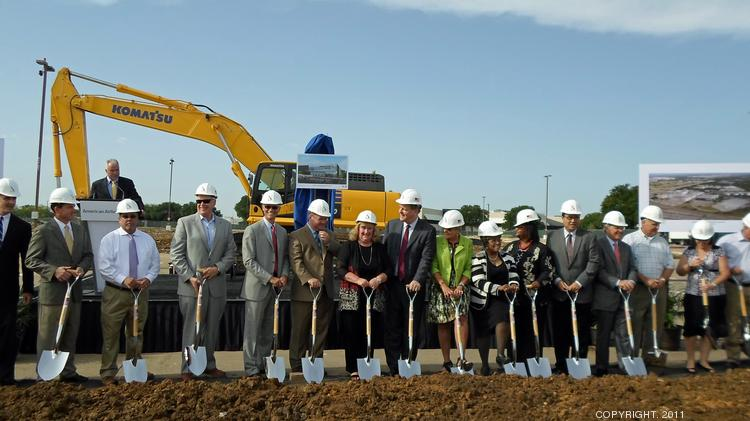 Officials and members of the Baker family break ground on the new Robert W. Baker Integrated Operations Center.